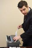Businessman Shredding Documents Royalty Free Stock Photos
