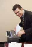 Businessman Shredding Documents Stock Photography