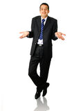 Businessman shrugging both shoulders Stock Photography