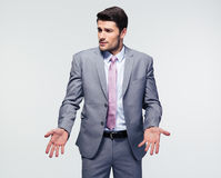 Businessman shrugging shoulders Stock Photography