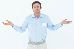 Businessman shrugging shoulders over white background Royalty Free Stock Photo