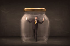 Businessman shut into a glass jar concept Stock Photos