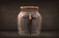 Businessman shut into a glass jar concept Stock Photos