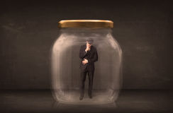Businessman shut into a glass jar concept Stock Photo