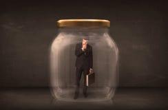 Businessman shut into a glass jar concept Stock Photography