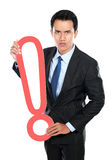 Businessman with a sign exclamation mark Stock Photo