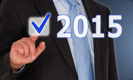 Businessman and 2015 sign Stock Image