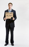 Businessman with sign ill work for food. Businessman with an unemployment sign Stock Photo