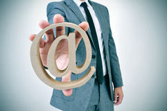 Businessman with an at sign Stock Photo