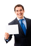 Businessman with signboard Royalty Free Stock Photos