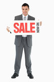 Businessman with signboard Stock Photography