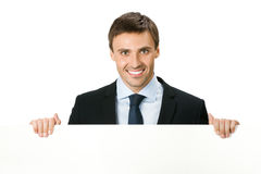 Businessman with signboard, on white Royalty Free Stock Photo