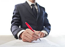 Businessman Signing Royalty Free Stock Images