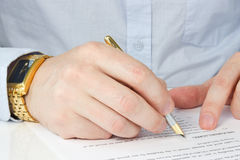 Businessman signing agreement Stock Images