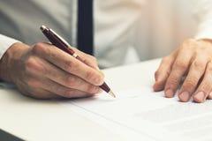 Businessman signing business partnership contract Stock Photos