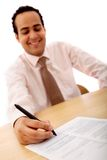 Businessman signing a contract Royalty Free Stock Image