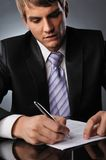 Businessman signing a contract Royalty Free Stock Photos