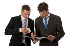 Businessman signing a contract. Stock Image