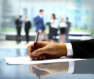 Businessman is signing a contract Royalty Free Stock Photo