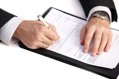 Businessman signing a contract Royalty Free Stock Images