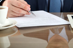 Businessman is signing a contract, business contract details Royalty Free Stock Photography
