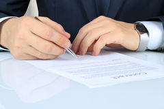 Businessman is signing a contract, business contract details Royalty Free Stock Image