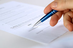 Businessman is signing a contract, business contract details Royalty Free Stock Images