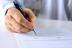 Businessman is signing a contract, business contract details Stock Photos