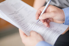 Businessman is signing a contract, business contract details Stock Photo