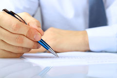 Businessman is signing a contract, business contract details Royalty Free Stock Photos