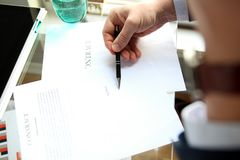 Businessman is signing a contract, business contract details. Businessman is signing a contract, business contract details Royalty Free Stock Photography