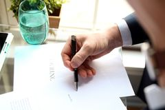 Businessman is signing a contract, business contract details. Royalty Free Stock Image
