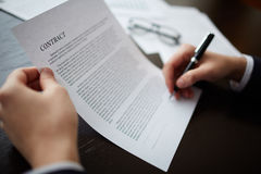 Businessman signing a contract. Close-up of male hands signing a contract with pen Royalty Free Stock Images