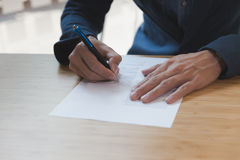 businessman signing contract document making a deal at office, b Stock Photo