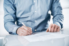 Businessman signing a contract or document Stock Image