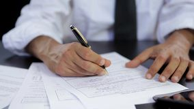 Businessman signing contract Stock Image