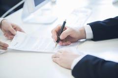 Businessman signing contract Stock Photos