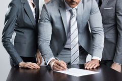 Businessman signing contract Stock Photography