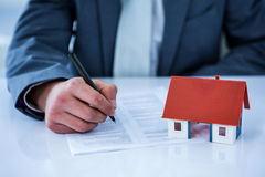 Businessman signing contract for new house Royalty Free Stock Photo