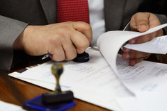 Signing contract. Businessman signing contract papers with a pen Royalty Free Stock Photos