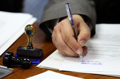 Signing contract. Businessman signing contract papers with a pen Royalty Free Stock Photo