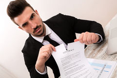 A businessman signing a Contract Royalty Free Stock Photos