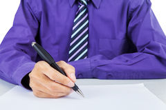 Businessman signing a contract Stock Images
