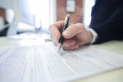 Businessman signing a contract Stock Photography