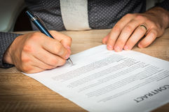 Businessman is signing a contract to conclude a deal Royalty Free Stock Images