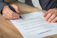 Businessman signing a contract to conclude a deal. Business concept royalty free stock photography