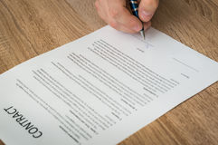 Businessman signing a contract to conclude a deal. Business concept royalty free stock images