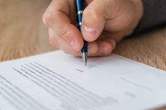 Businessman is signing a contract to conclude a deal. Business concept royalty free stock photo