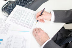 Businessman signing a contract. View of a businessman signing a contract Stock Photo