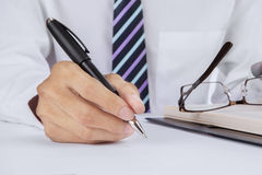 Businessman signing on a desk Stock Photography